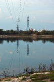 Power line over the River. Royalty Free Stock Images