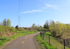 Power line park bike route, walking path Royalty Free Stock Images