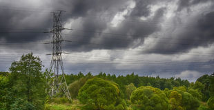 Power line. Passes in the Park near the pond Royalty Free Stock Photos