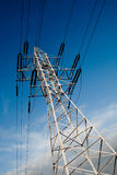 Power line pole over blue sky background. Power line pole on blue sky background Stock Photography