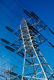 Power line pole over blue sky background. Power line pole on blue sky background Royalty Free Stock Photo