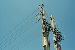 Power-line poles. Concrete pole with power lines and insulators Stock Photo
