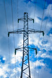 Power line post against the blue sky Stock Photography