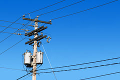 Power line post and blue sky Stock Images