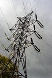 Power line pylon. Top against sunny cloudy sky Stock Photo