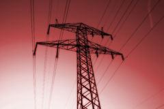 Power line pylon. Electric power line pylon in monochrome reds stock photography