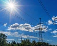 Power Line. pylon against a blue sky and sun. Power Line. pylon against a blue sky and sun Stock Images