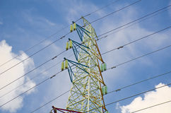 Power line pylon against the sky. A picture of electrical power transsmission lines that transfer electricity generate in the power station to the main intake Stock Photos