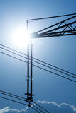 Power line pylon and sun Royalty Free Stock Photo