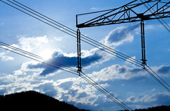Power line pylon and sun Stock Photos