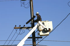 Power line Repair 1. A repairman working on power pole Royalty Free Stock Images