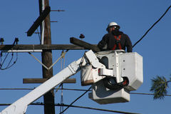 Power line Repair 2. A repairman working on power pole Royalty Free Stock Image