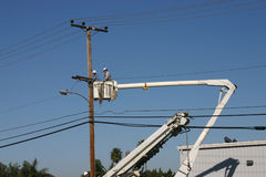 Power line Repair 3. A repairman working on power pole Royalty Free Stock Photos