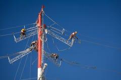 Power line repairs Stock Photos