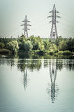 Power line. The power line on a river Stock Image