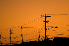Power Line Silhouettes Stock Image