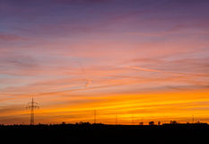 Power line silhouettes with beautiful sky Stock Photos