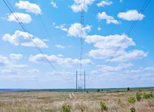 Power line in the steppes. Wires against the sky Stock Images