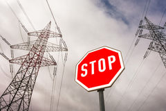 Power line and stop sign Royalty Free Stock Image