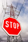 Power line and stop sign Royalty Free Stock Images