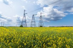 Power line summer landscape. / passing overhead electricity wire of the support carrying the light and the heat in the house stock photo