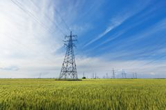 Power line summer landscape. / passing overhead electricity wire of the support carrying the light and the heat in the house royalty free stock photo