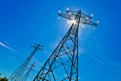 Power line with sun Stock Image