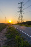 Power line in Sun set Royalty Free Stock Photography