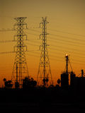 Power Line Sunset. Power transmission lines and towers in silhouette against a sunset sky Royalty Free Stock Photo