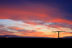 Power line at sunset Royalty Free Stock Photography