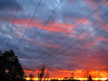 Power Line Sunset Perspective v1. Power Line Sunset Perspective captured with beautiful blue and orange skies stock photography