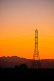 Power Line Tower. High tension power line tower sillouetted at sunset Royalty Free Stock Images