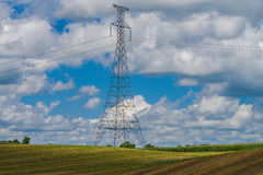 Power line tower above farmland Royalty Free Stock Photo