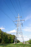 Power line tower against blue sky Stock Photography