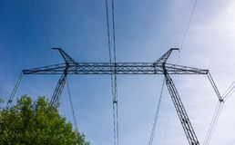 Symbol of energy and power. Power line tower on a blue sky background. symbol of energy and power Royalty Free Stock Images