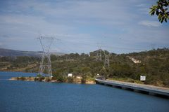 Power Line tower on the lake Royalty Free Stock Images