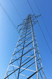Power line. Tower of power lines against the blue sky Stock Photos