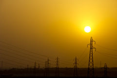 Power line tower and sunset Royalty Free Stock Photos