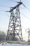 Power line. The tower transmits electricity in the house Royalty Free Stock Photo