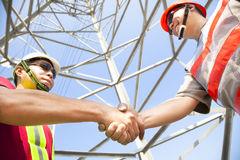 Power line tower workers Stock Photos