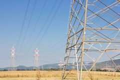 Power-line towers. Long lines of power-line towers Royalty Free Stock Photo