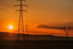Power Line Towers At Sunset Royalty Free Stock Images