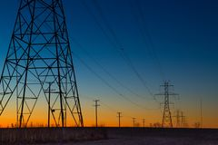 Power line towers during blue hour. In Mokena, Illinois stock images