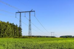 Power line transmission of electrical energy on high-voltage metal structures.  royalty free stock photography