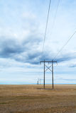 Power line under Clouds at angle Royalty Free Stock Image