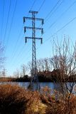 Power line in the water. Royalty Free Stock Photo