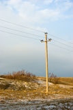 Power line in winter dune of Curonian spit. Russia Stock Photography