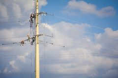 Power line workers Stock Image