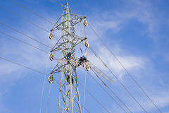 Power line workers Stock Images