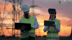 Two electricians using modern 3D virtual reality glasses for engineering in augmented reality. stock video footage